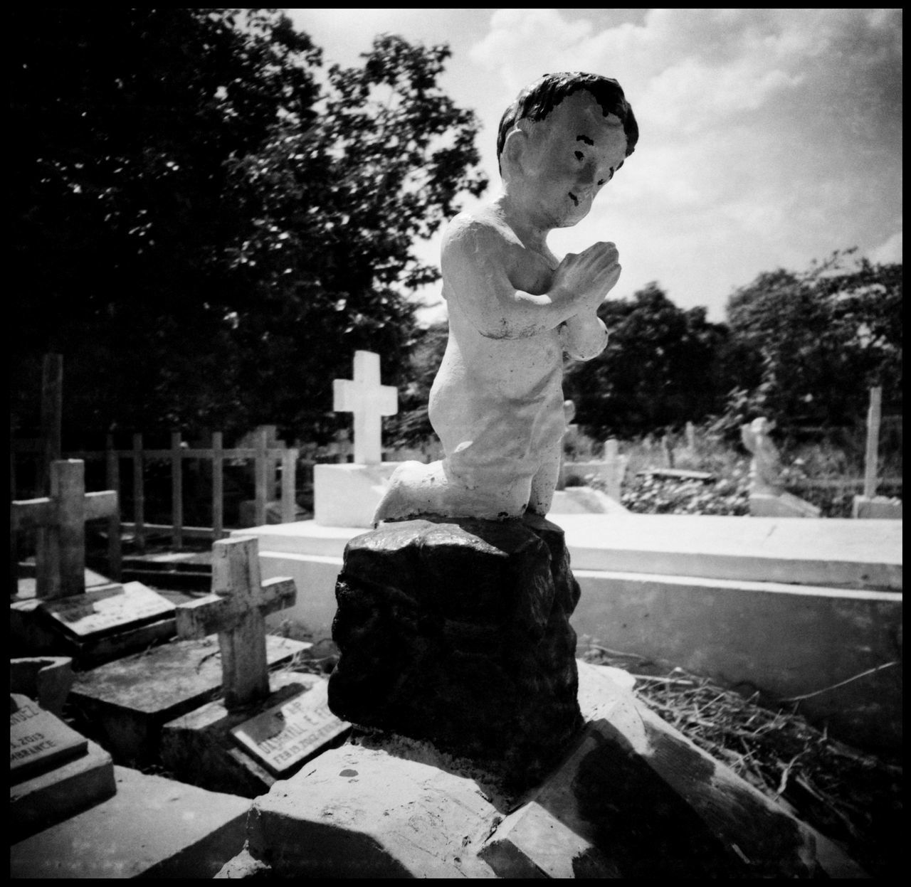 Manilas Southern Graveyard - Intense Grave Sitting Abandoned Places Analogue Photography Angel ASIA Baby Graves Black And White Brothers Cemetery Coffins  Death Film Photography Grain Grave Boxes Grave Sitting Grave Stones Graveyard Madonna Manila Partner Philippines Sitting On Grave Stare The Photojournalist - 2017 EyeEm Awards Travel