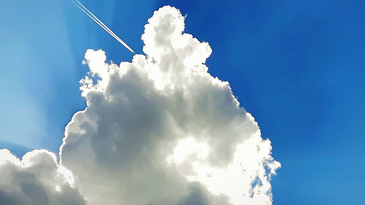 cloud - sky, sky, low angle view, blue, white color, day, nature, outdoors, beauty in nature, no people, vapor trail