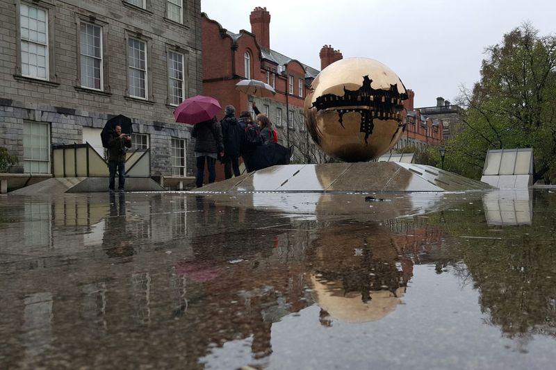 Tourists In The Rain