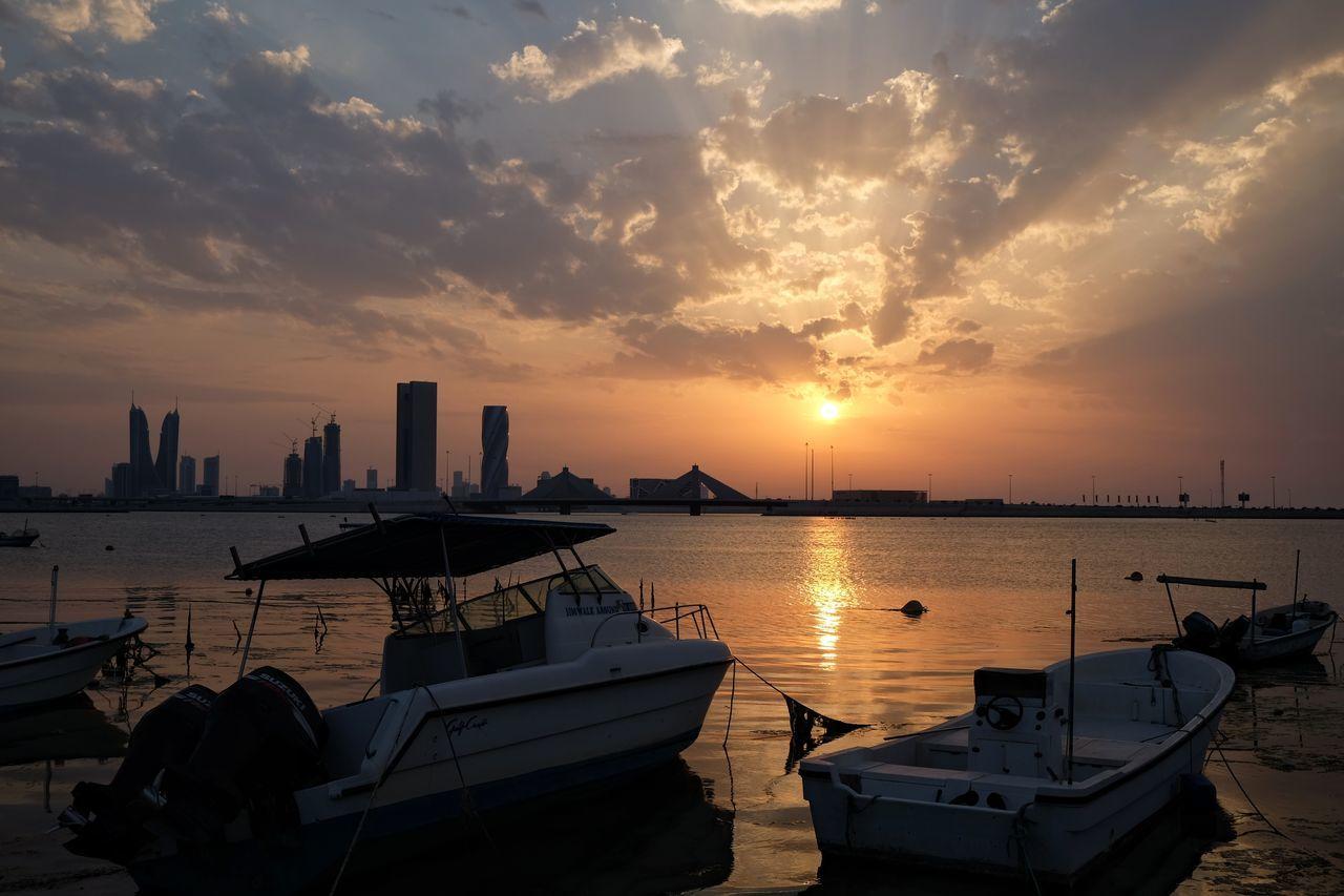 Sunset Cityscape Nautical Vessel Sunrays Urban Skyline Fishing Boats Calm Sea
