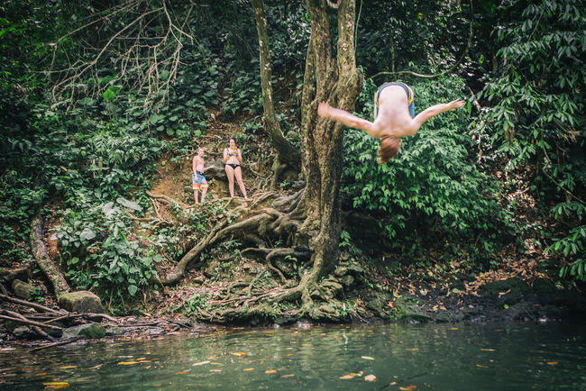 The Great Outdoors – 2016 EyeEm Awards Check This Out Rope Swing Waterhole Kids Playing Backflip Swinging In A Tree Swimming Costa Rica Rainforest Enjoying Life Friends Outdoor Activity Cooling Off