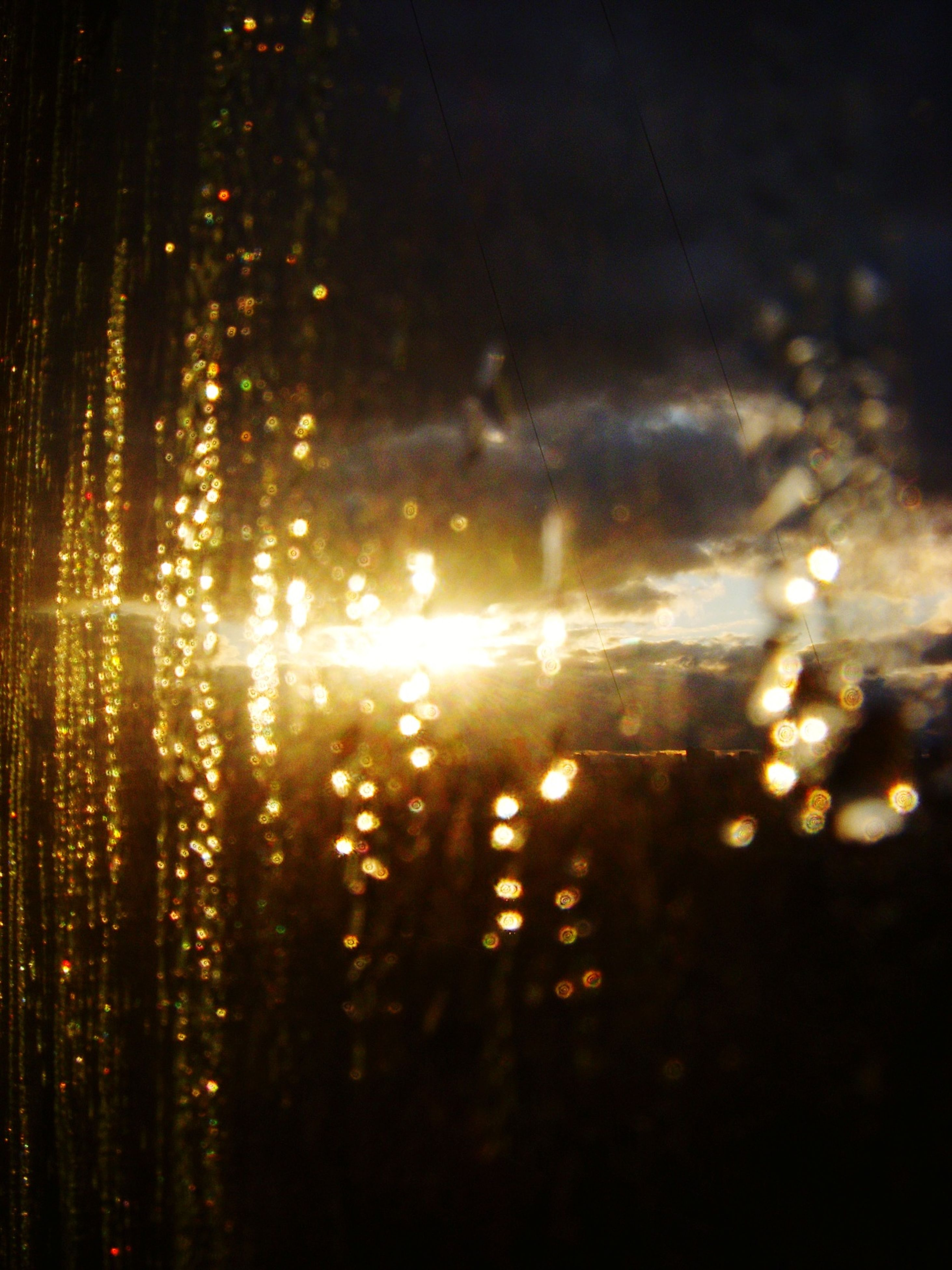 wet, window, rain, drop, water, sunset, night, transparent, glass - material, sun, illuminated, silhouette, sky, lens flare, backgrounds, full frame, raindrop, weather, no people, reflection