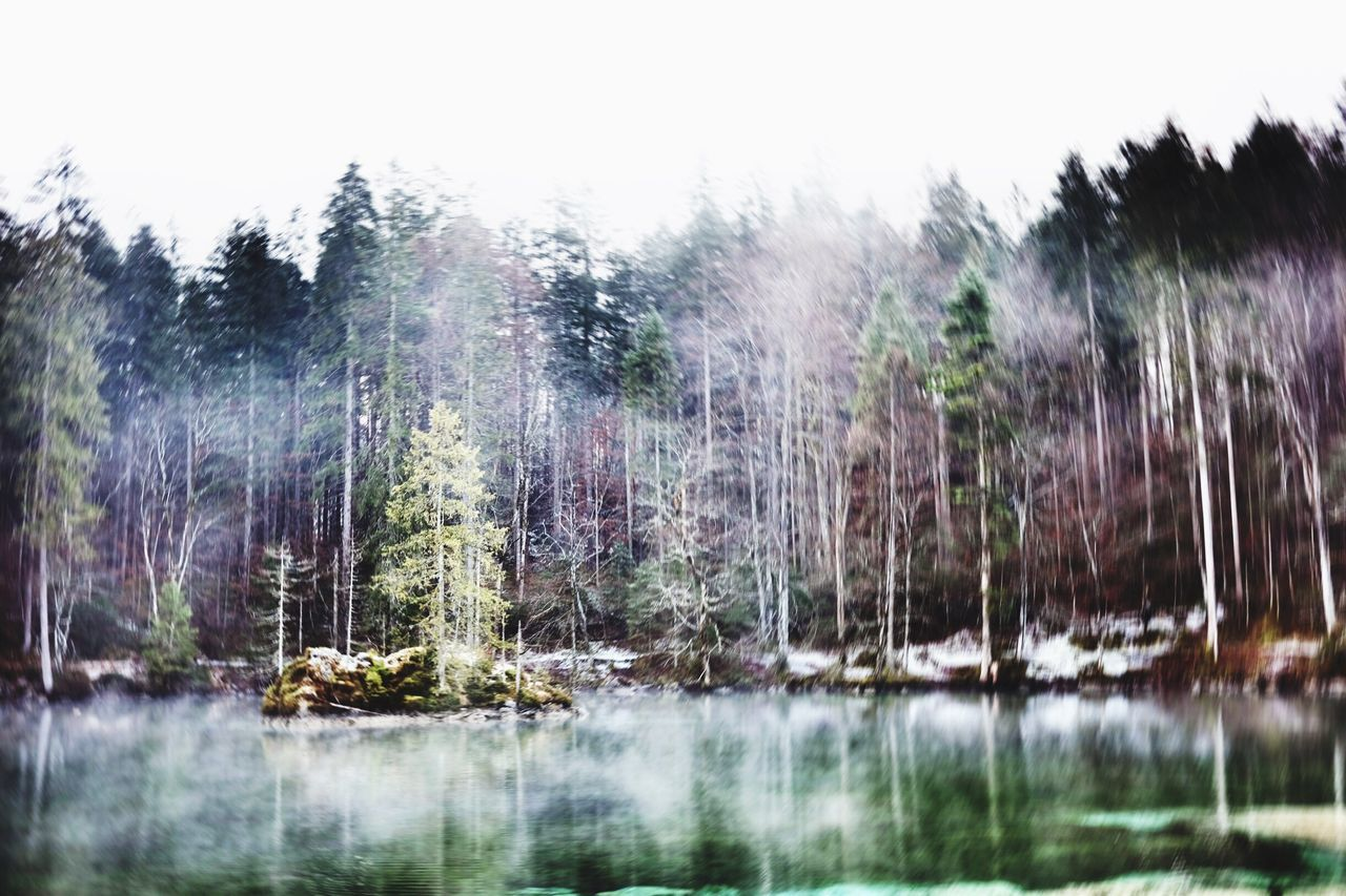 Meditative Nature at Badersee Lake in the Alps . Relaxing Foggy Weather Island Mountain Lake Water