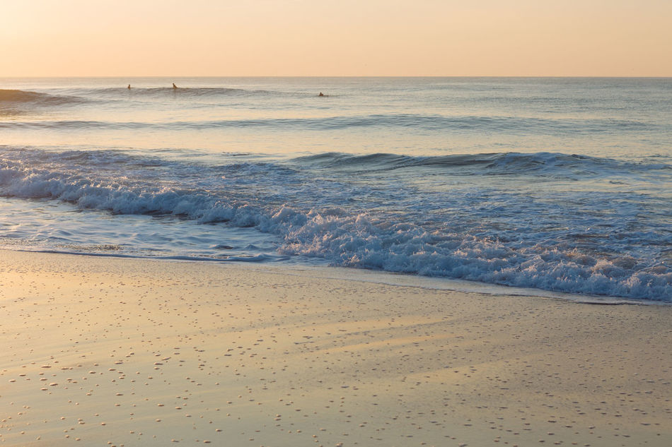 Beach Beauty In Nature Clear Sky Day Dusk Horizon Over Water Nature No People Outdoors Sand Scenics Sea Sky Sunset Travel Destinations Vacations Water Water's Edge Wave
