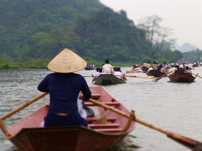 Perfume Pagoda Vietnam. All of the boat rowers are war widows Reflecting . Strong Women Perfume Pagoda