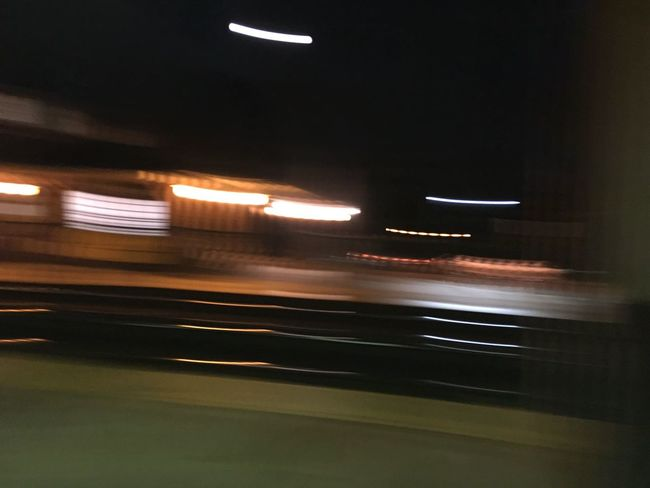 Blurred Motion City City Life Dark Illuminated Land Vehicle Light Trail Mode Of Transport Motion Night No People On The Move Road Transportation
