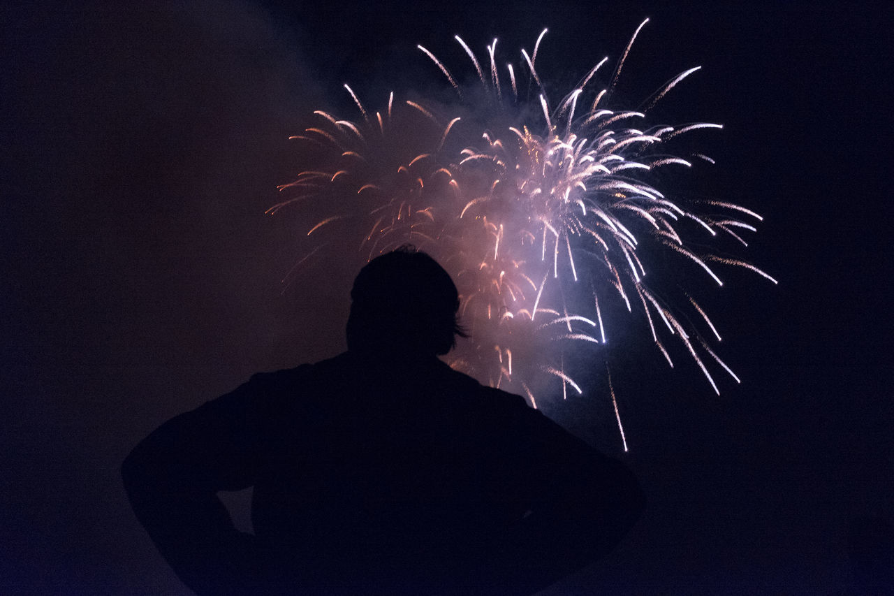 Celebration Entertainment Event Exploding Firework - Man Made Object Firework Display Glowing Illuminated Long Exposure Motion Night Outline Sky Sparks Standing