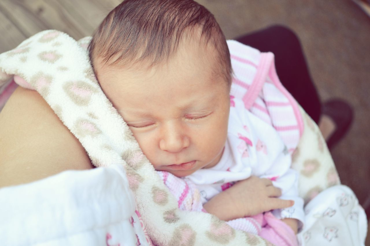 baby, real people, babyhood, sleeping, innocence, newborn, cute, eyes closed, indoors, new life, childhood, fragility, one person, relaxation, lying down, home interior, close-up, day