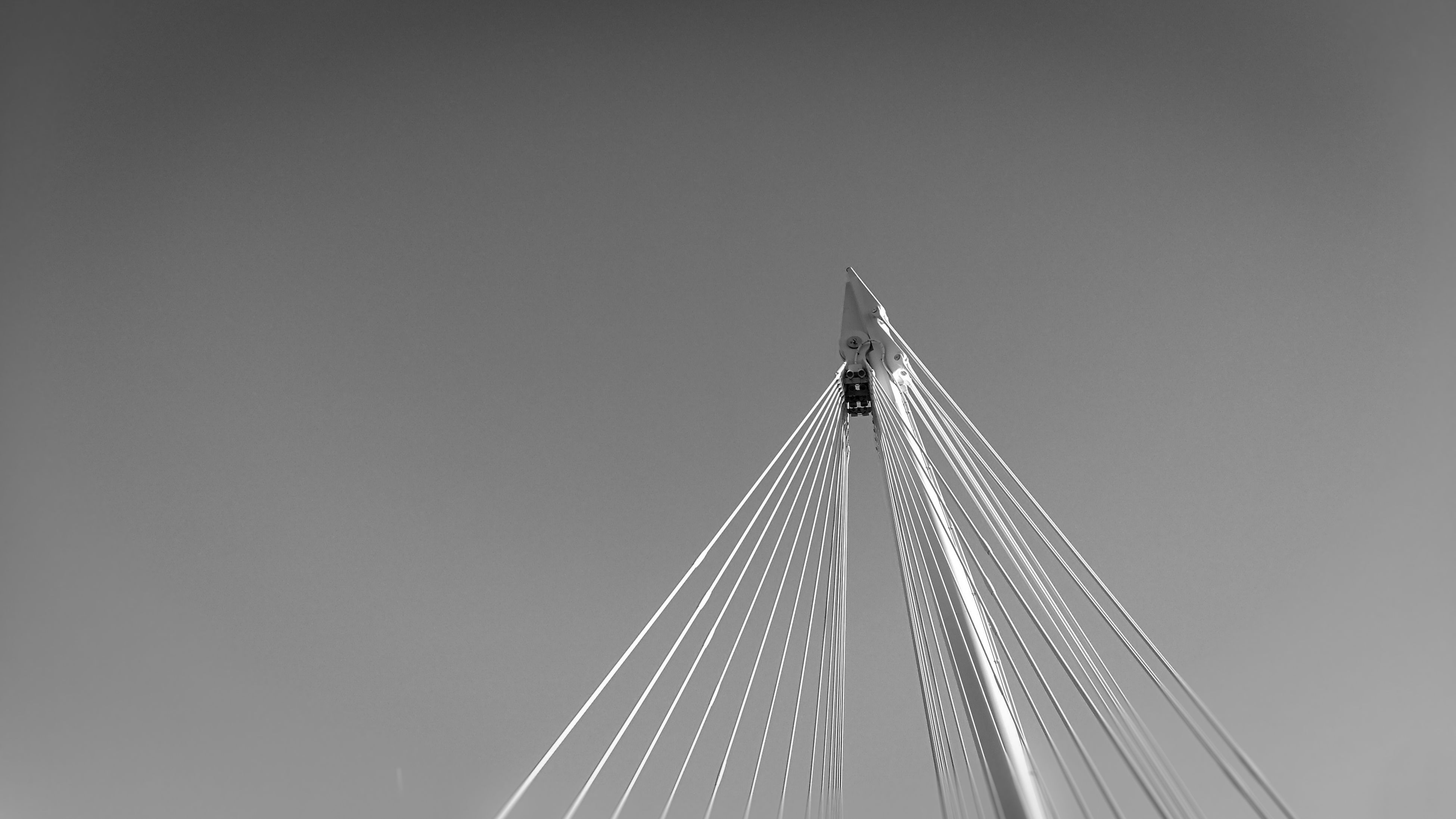 sky, low angle view, architecture, built structure, connection, bridge - man made structure, no people, suspension bridge, outdoors, day