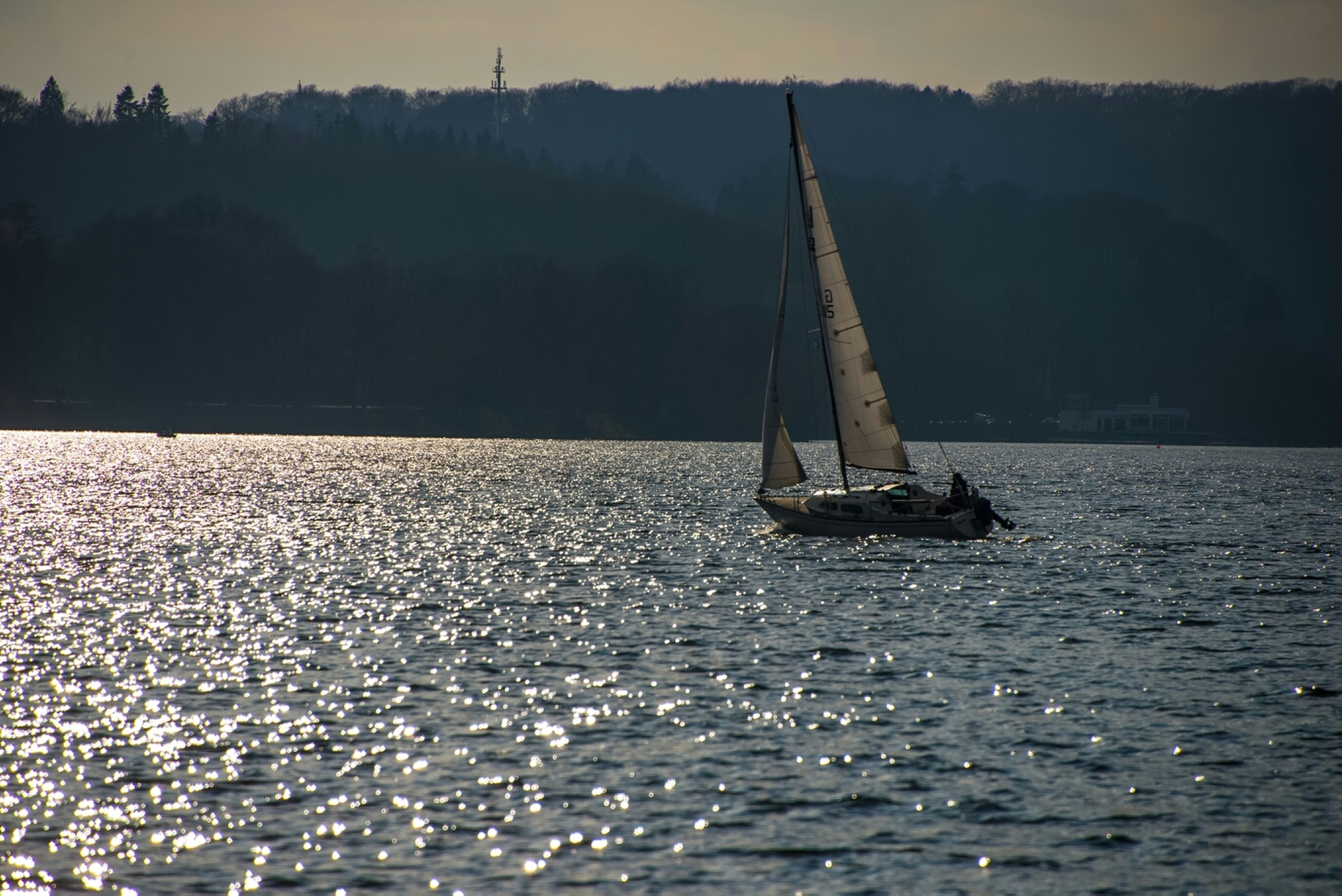transportation, water, nautical vessel, mode of transport, boat, waterfront, sea, tranquil scene, sailboat, nature, tranquility, sky, river, scenics, beauty in nature, rippled, sailing, travel, mast, silhouette