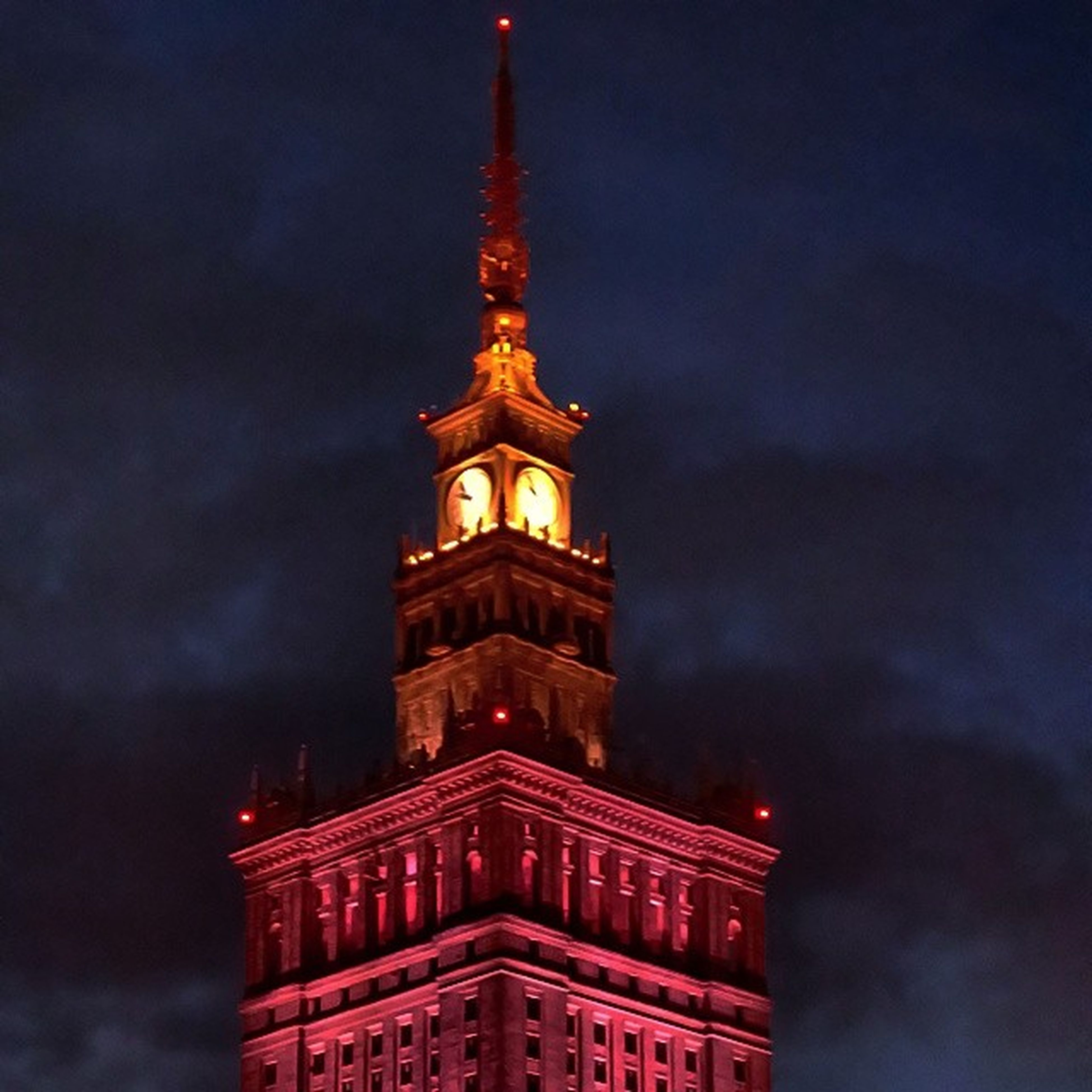 low angle view, architecture, built structure, building exterior, sky, tower, cloud - sky, travel destinations, famous place, tourism, clock tower, tall - high, international landmark, cloudy, travel, capital cities, illuminated, night, dusk, history