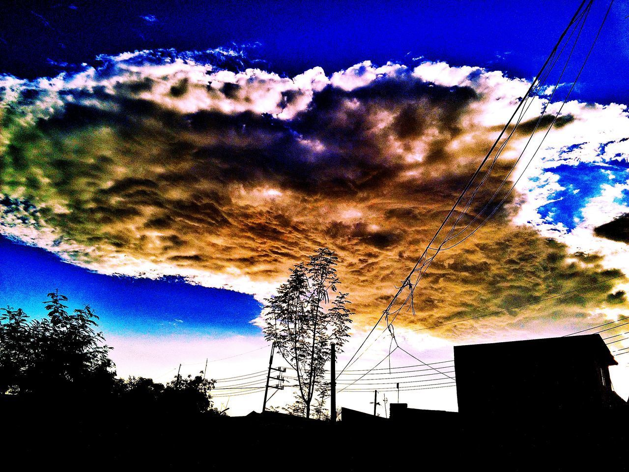 sky, cloud - sky, silhouette, low angle view, cable, no people, blue, outdoors, tree, sunset, nature, architecture, building exterior, beauty in nature, day, telephone line