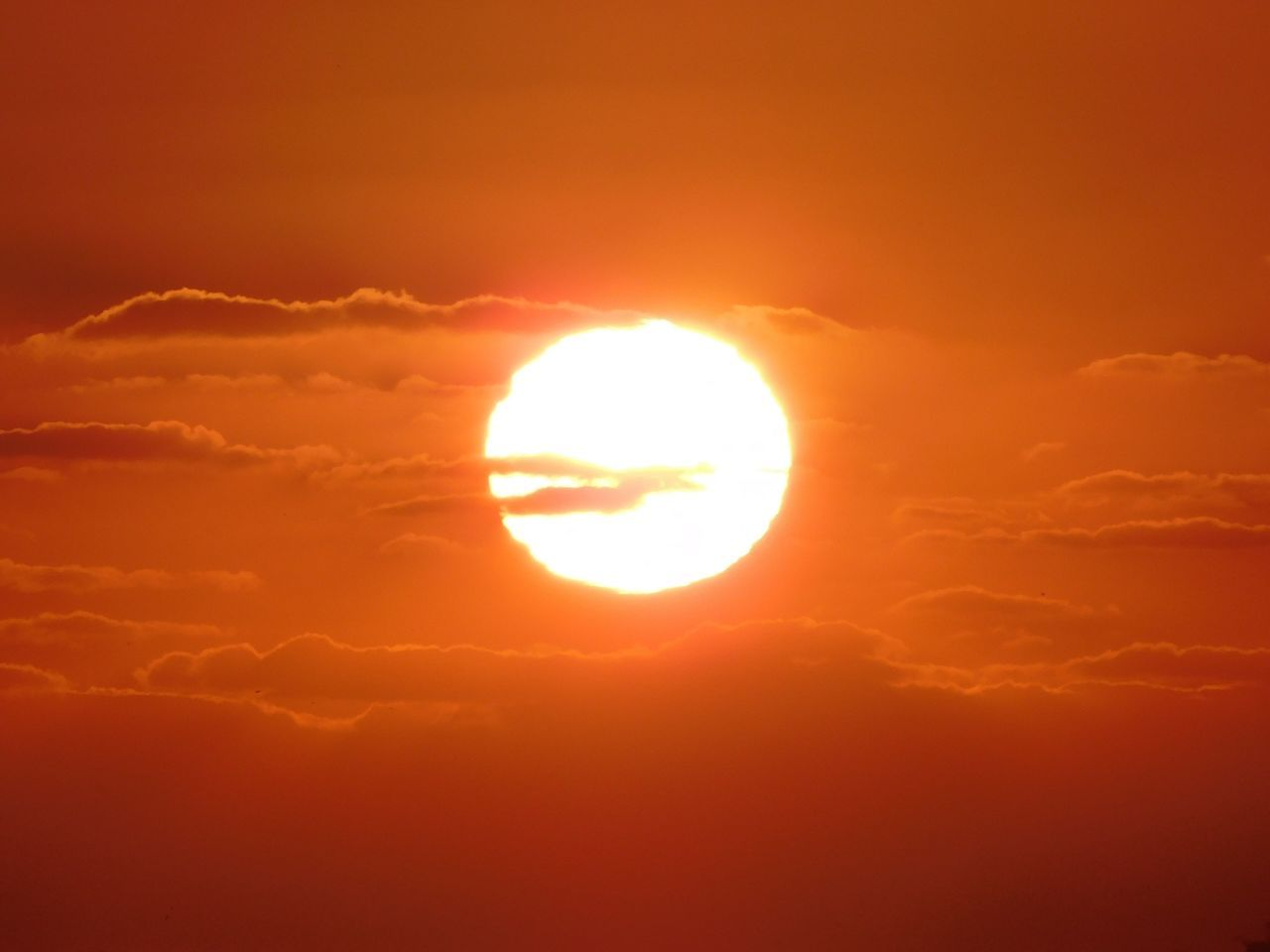 Scenic View Of Sun Against Orange Sky During Sunset
