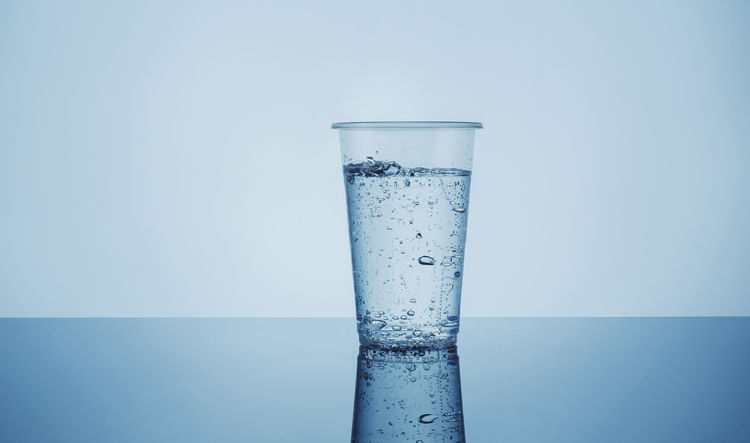sparkling water in a plastic cup Food And Drink Sparkling Sparkling Water Blue Cup Dissolving Drink Drinking Glass Drinking Water Freshness Healthy Healthy Lifestyle Liquid Mug No People Plastic Plastic Cup Purity Refelction  Refreshment Studio Shot Water