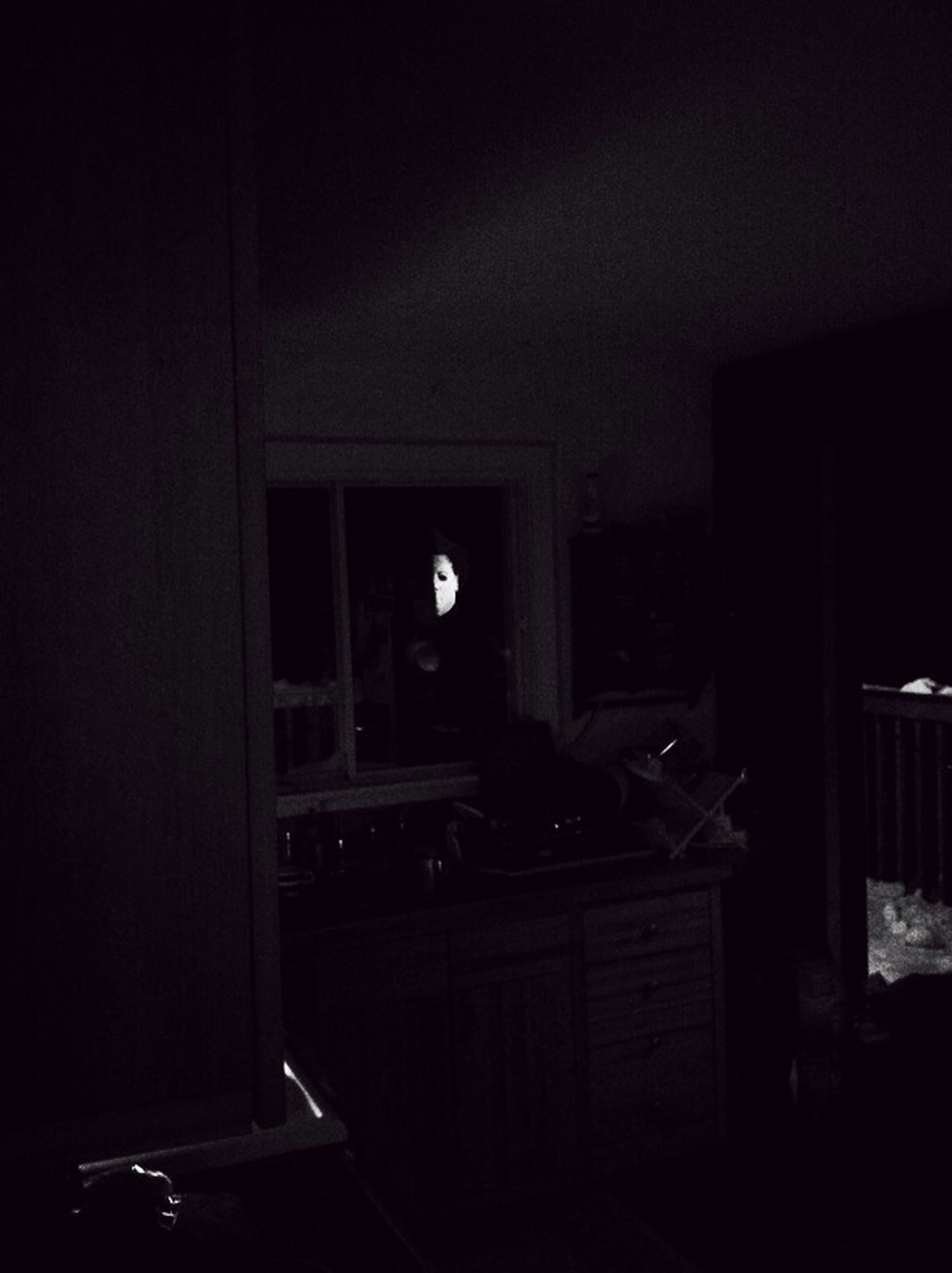 indoors, illuminated, night, dark, lighting equipment, home interior, house, built structure, architecture, table, window, electric lamp, room, chair, light - natural phenomenon, darkroom, absence, no people, door, domestic room