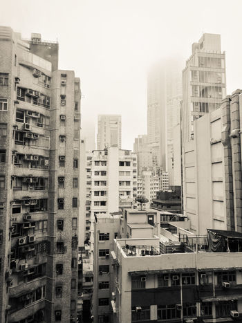 Tetris Skyscraper City Architecture Building Exterior Downtown District Cityscape Apartment Outdoors Urban Skyline No People Modern Hong Kong Building HongKong Hong Kong Architecture Hong Kong Skyscraper Rooftops Tall Buildings Residential District Residential Buildings Foggy Weather Monochrome Upright Moody Sky Moody Day  Residential And Business District The Architect - 2017 EyeEm Awards Black And White Friday An Eye For Travel