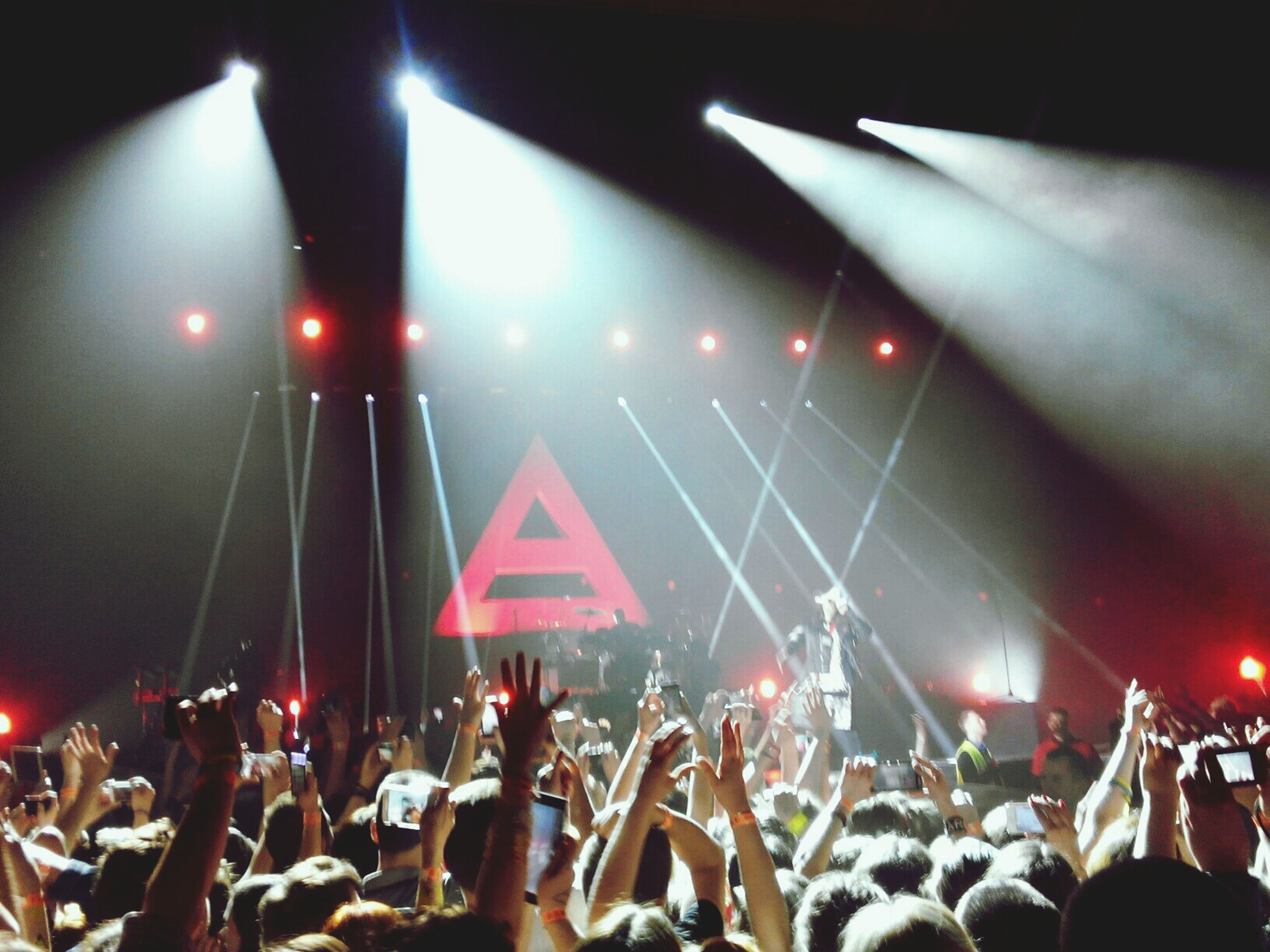 illuminated, large group of people, crowd, night, lifestyles, men, leisure activity, person, nightlife, indoors, lighting equipment, performance, celebration, arts culture and entertainment, music, event, youth culture, light - natural phenomenon