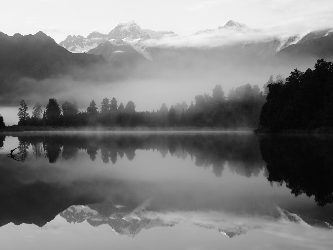 Reflection Water Lake Nature Tranquility Mountain Scenics Tree Beauty In Nature Tranquil Scene No People Sky Fog Outdoors Day Calm Water Reflections Mirror Lake New Zealand Lake Matheson Foggy Morning Light Symmetry Silence Blackandwhite