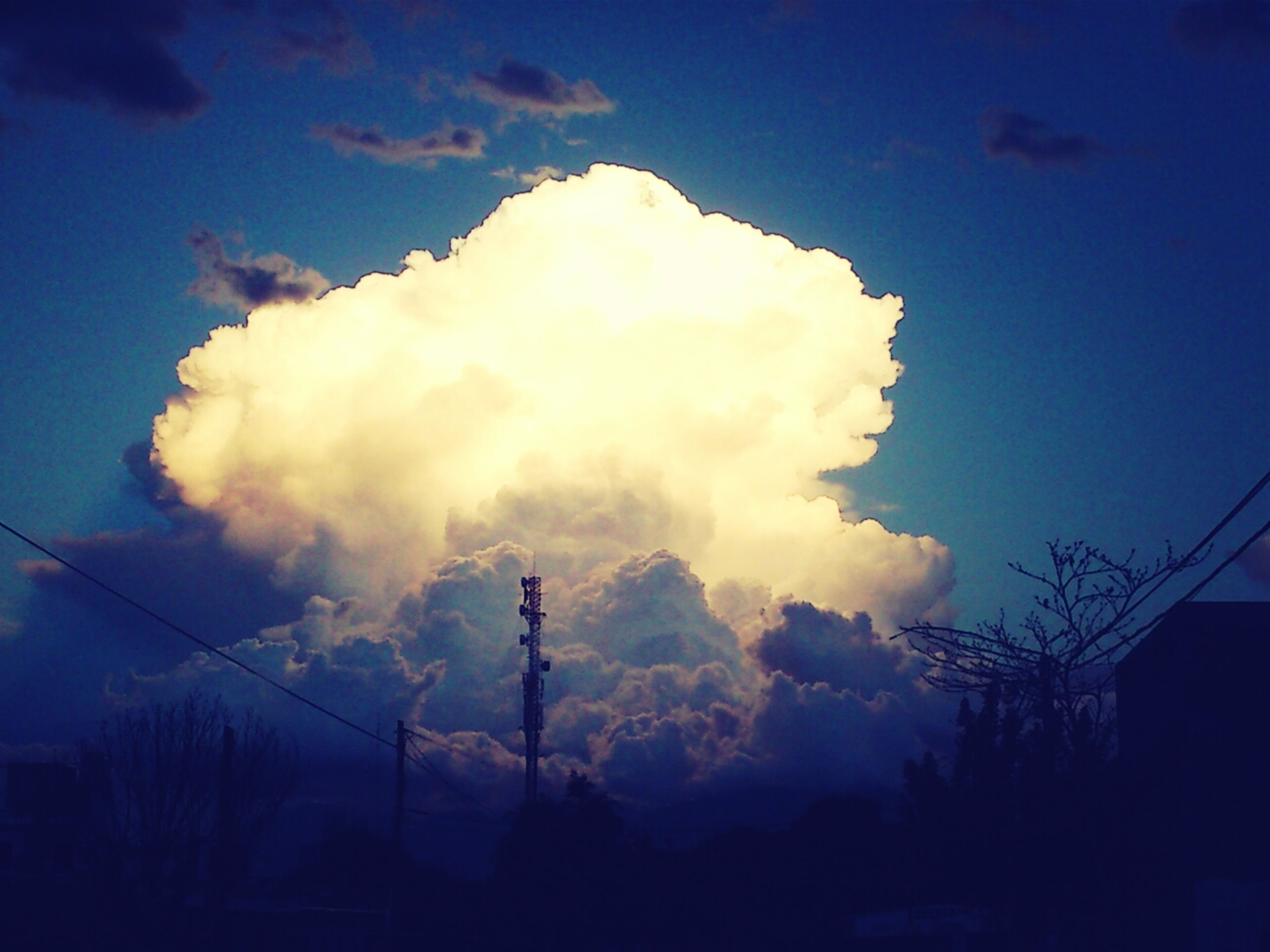 sky, low angle view, cloud - sky, silhouette, electricity, power line, electricity pylon, cloudy, power supply, cloud, nature, technology, built structure, dusk, weather, lighting equipment, cable, fuel and power generation, street light, beauty in nature