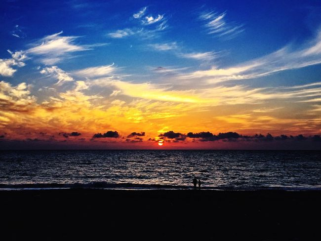 Sunset Sea Water Beauty In Nature Silhouette Horizon Over Water Tranquility Outdoors Nature Sky Sun Clouds
