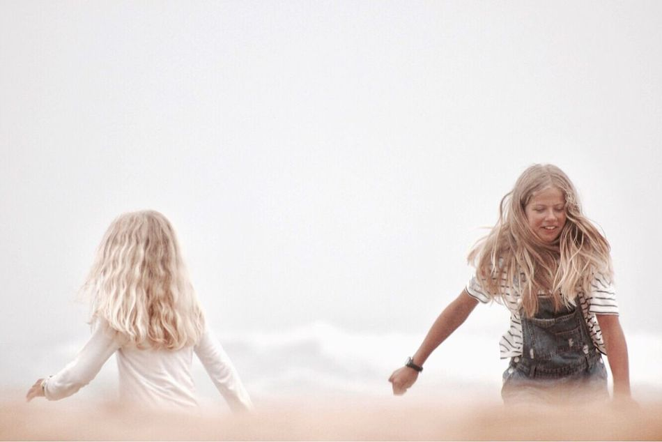 Two People Blond Hair People Selective Focus The Week On EyeEem Minimalobsession Minimalism Minimal Close-up Real People Helloworld Photography Freedom Capture The Moment Roadtrip Beach Foggy Fog Morning Tourist Family Vscocam VSCO Beach Time Portugal