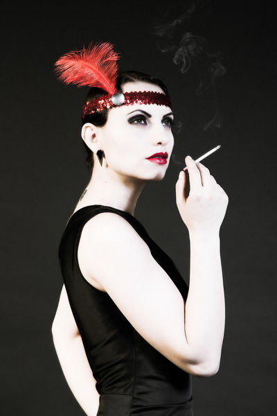 1920s Art Feather  Lifestyles Outoftime Portrait Red And Black Smoke Spooky Studio Shot