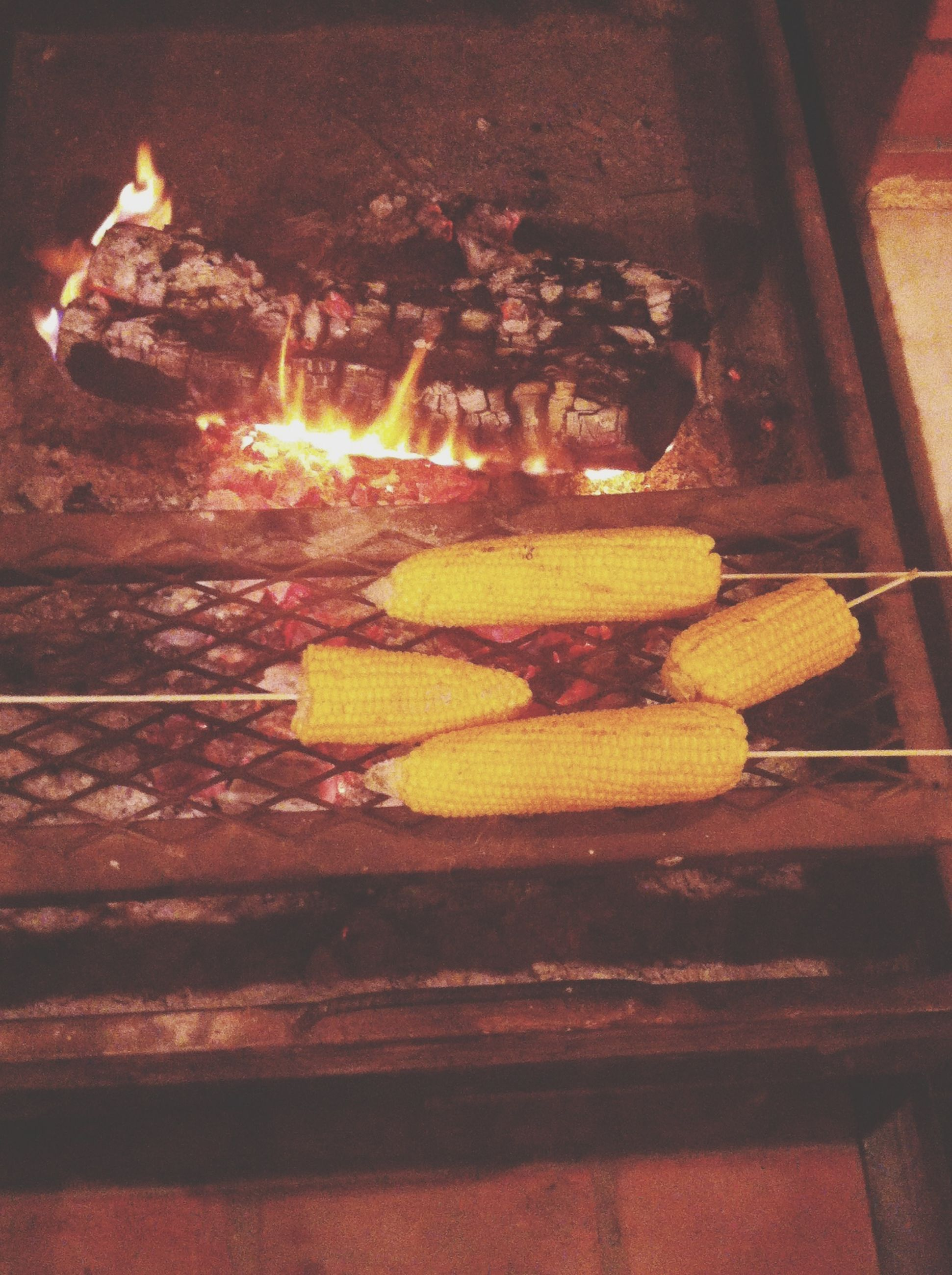 food and drink, food, flame, burning, yellow, freshness, orange color, fire - natural phenomenon, indoors, heat - temperature, close-up, wood - material, hanging, healthy eating, no people, fruit, wall - building feature, still life, day