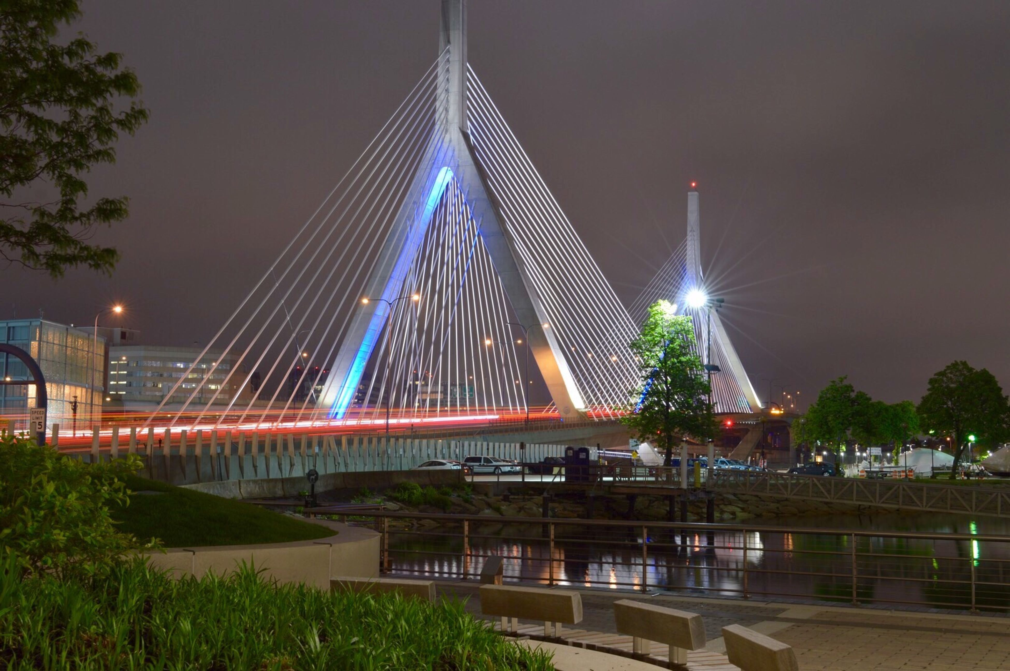 architecture, illuminated, built structure, night, outdoors, connection, bridge - man made structure, long exposure, tree, travel destinations, building exterior, no people, sky, water, city, nature