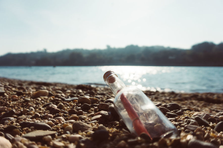 Beach Beauty In Nature Close-up Coastline Day Focus On Foreground Horizon Lake Message In A Bottle Nature Non-urban Scene Pebble Sand Scenics Secret Selective Focus Shore Surface Level Tranquil Scene Tranquility Water Water Surface Zoology