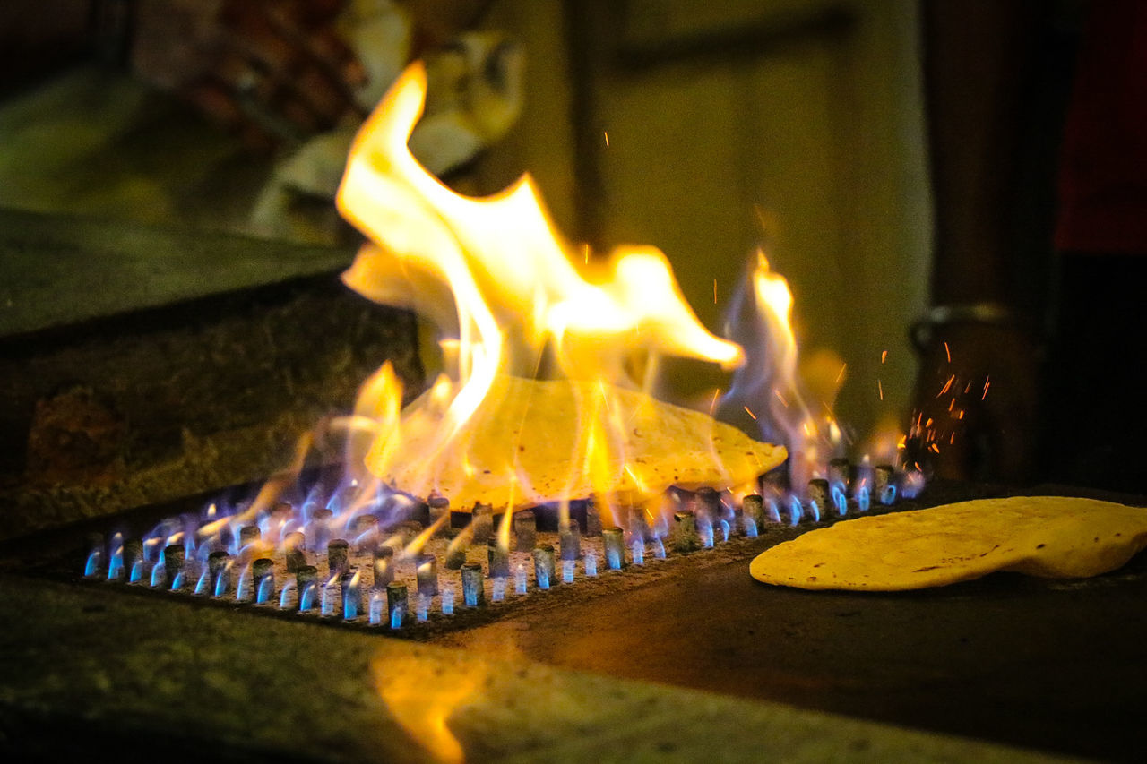 Flame Burning Heat - Temperature Night No People Close-up Illuminated Food Indoors  Flat Bread India Food Chef Preparation  Preparing Food Indian Spices Spices Of The World Indian Food Roti