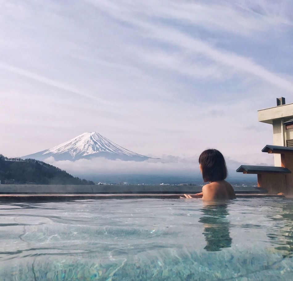 Onsen with a view. Fuji view. Japan Mountain Rear View Beauty In Nature Scenics One Person Sky Nature Real People Leisure Activity Day Waterfront Sea Tranquil Scene Outdoors Women Young Adult Onsen Wanderlust Travelgoals Travelphotography Travelgram Selfie ✌ Fuji Mtfuji