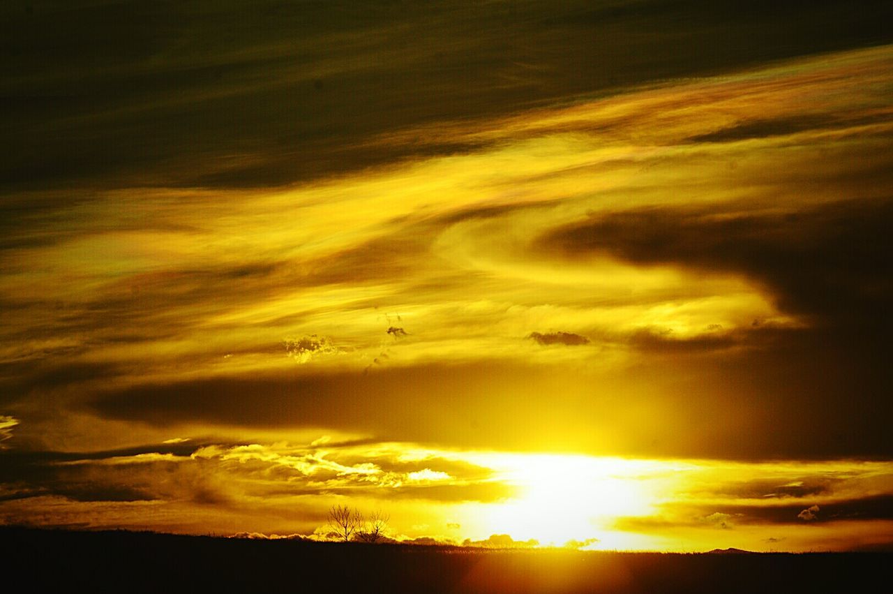 sunset, cloud - sky, nature, beauty in nature, yellow, sky, dramatic sky, majestic, cloudscape, scenics, silhouette, tranquility, backgrounds, no people, tranquil scene, sky only, sun, low angle view, outdoors, day