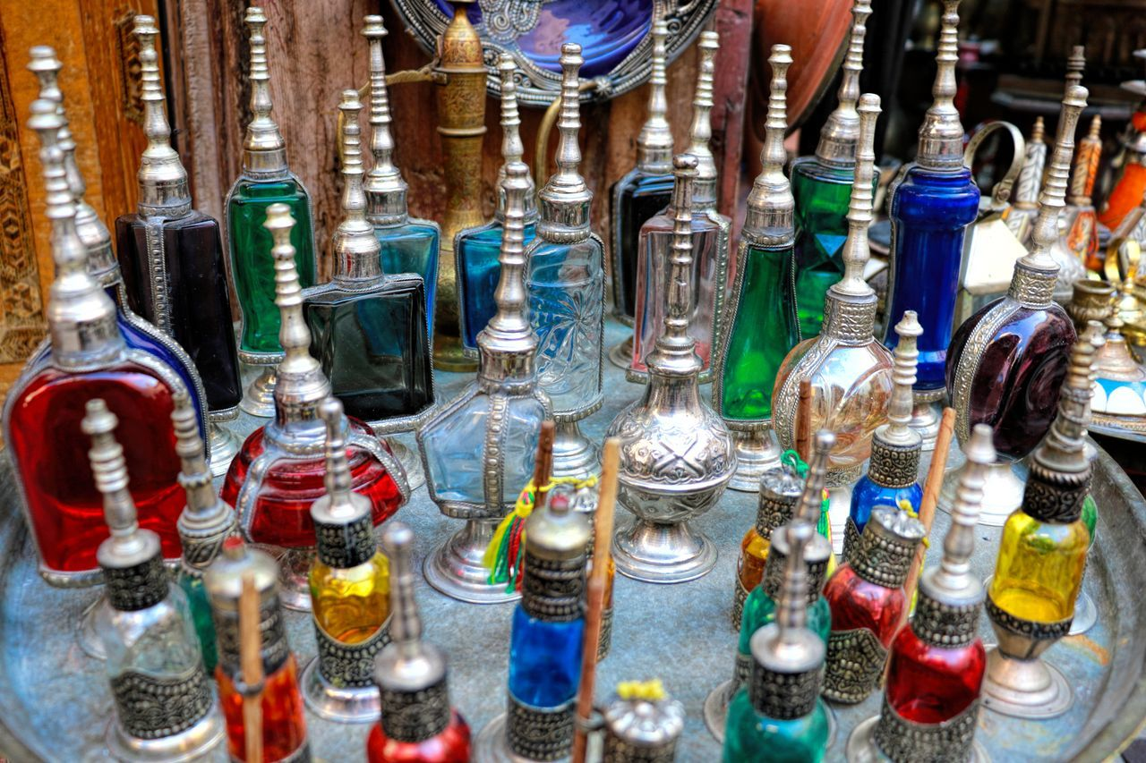 Bazaar Choice Close-up Colorful Bottles Crystal Glassware Day Exotic For Sale Large Group Of Objects Market Market Stall Morocco No People Oils Outdoors Perfume Retail  Variation