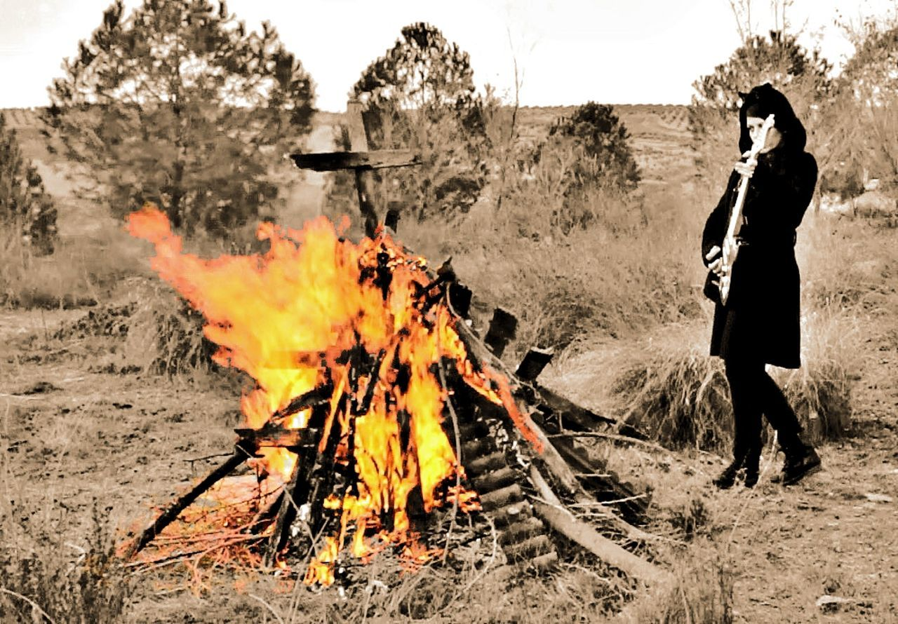 Heat - Temperature Burning Flame Real People One Person Outdoors Men Holding Tree Forest Fire Full Length Smoke - Physical Structure Day Adults Only Nature Sky Adult People One Man Only Only Men EyeEm Gallery Olivia De Happyland Nature Photography Nature_collection Rock N Roll
