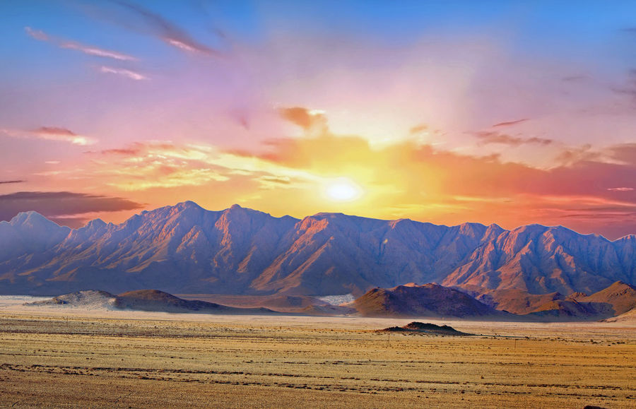 Beauty In Nature Blue Wave Cloud - Sky Day Hazy Sky Landscape Mountain Mountain Range Namib Naukluft National Park Namibia Nature No People Outdoors Pink Color Scenics Scenics Landscape Scenics Nature Sesriem Sesriem, Namibia Sky Sossusvlei Desert - Namibia Southern Africa Sunrise Sunset Travel Destinations