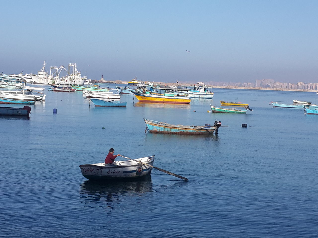 Alexandria Egypt Sea Boat Child Sea Life Boats⛵️ Boats And Water Morning Life Work Sky Blue Sky City Day Outdoors Blue