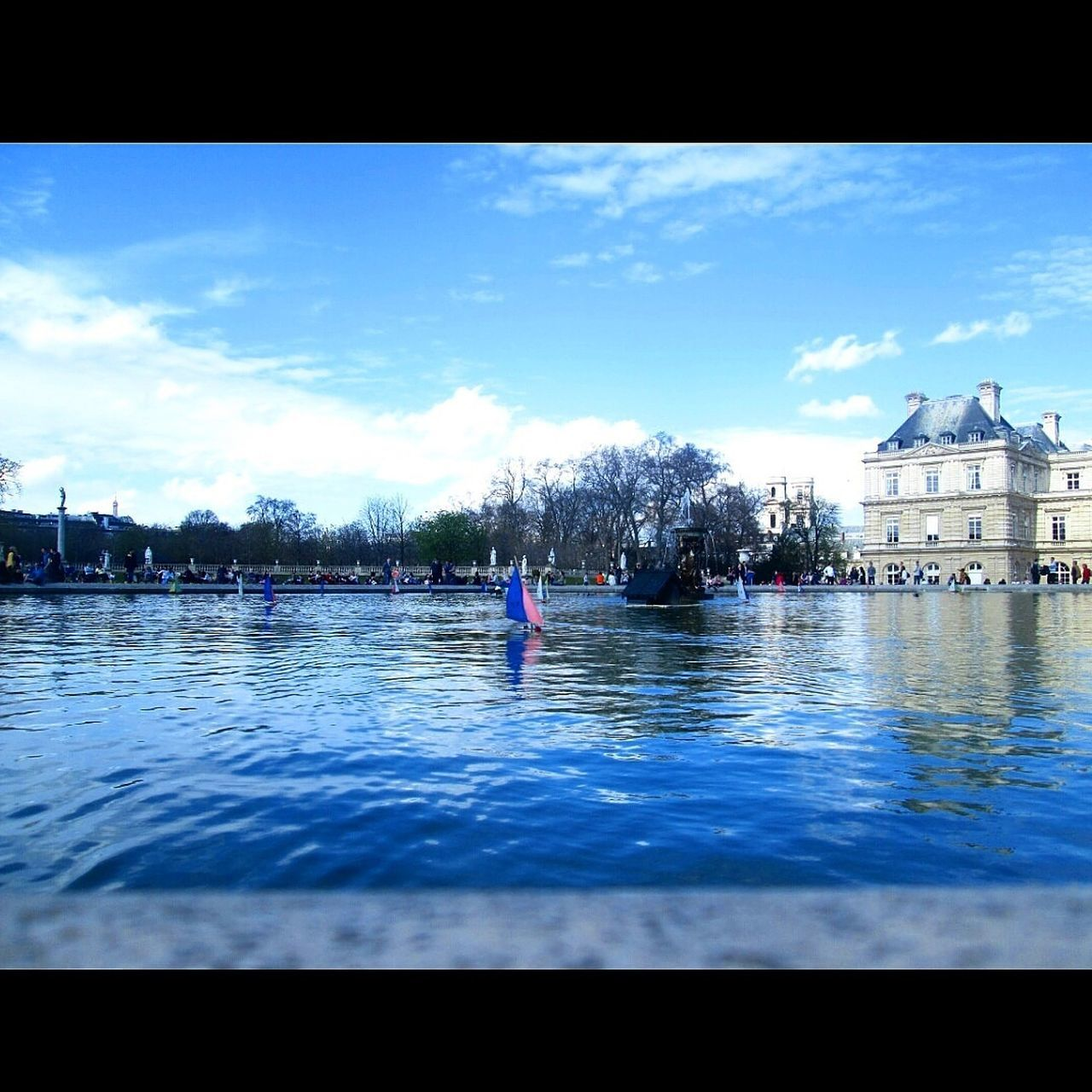 water, architecture, built structure, building exterior, sky, real people, day, outdoors, blue, one person, tree, nature, people