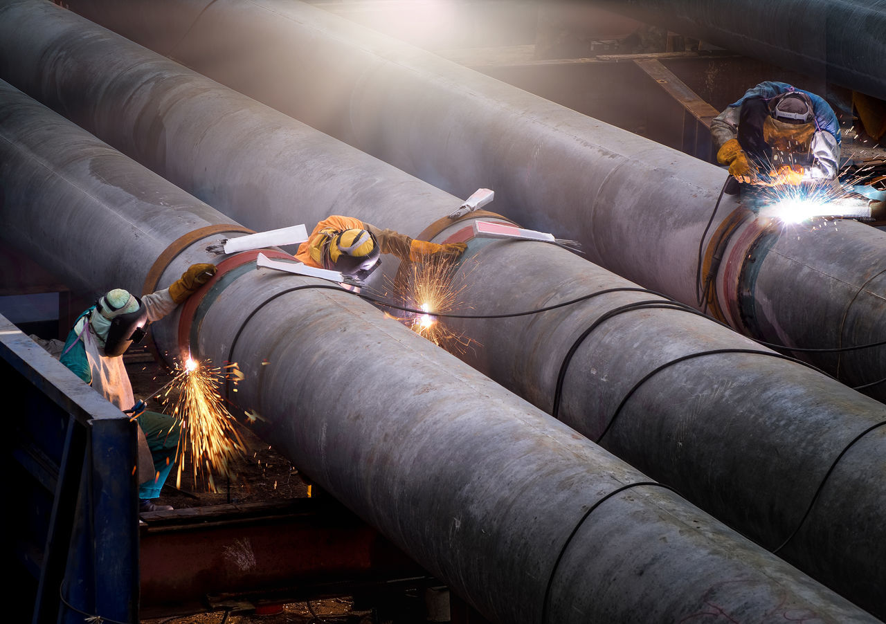 Welder Business Finance And Industry Tube Skill  Safety Pipeline Men Manual Worker Metal People Industry Indoors  Close-up Metal Industry Workshop Welding The Great Outdoors - 2017 EyeEm Awards Heat Grove Gas Factory Connect Industry Protective Workwear Mask
