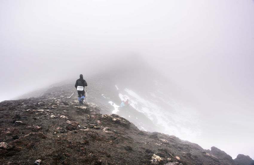 Trekker walks over misty mountain pass at Kamchatka Far East First Eyeem Photo Kamchatka Mountain Mountans Russia Tree Trekking TrekkingDay Winter Camp