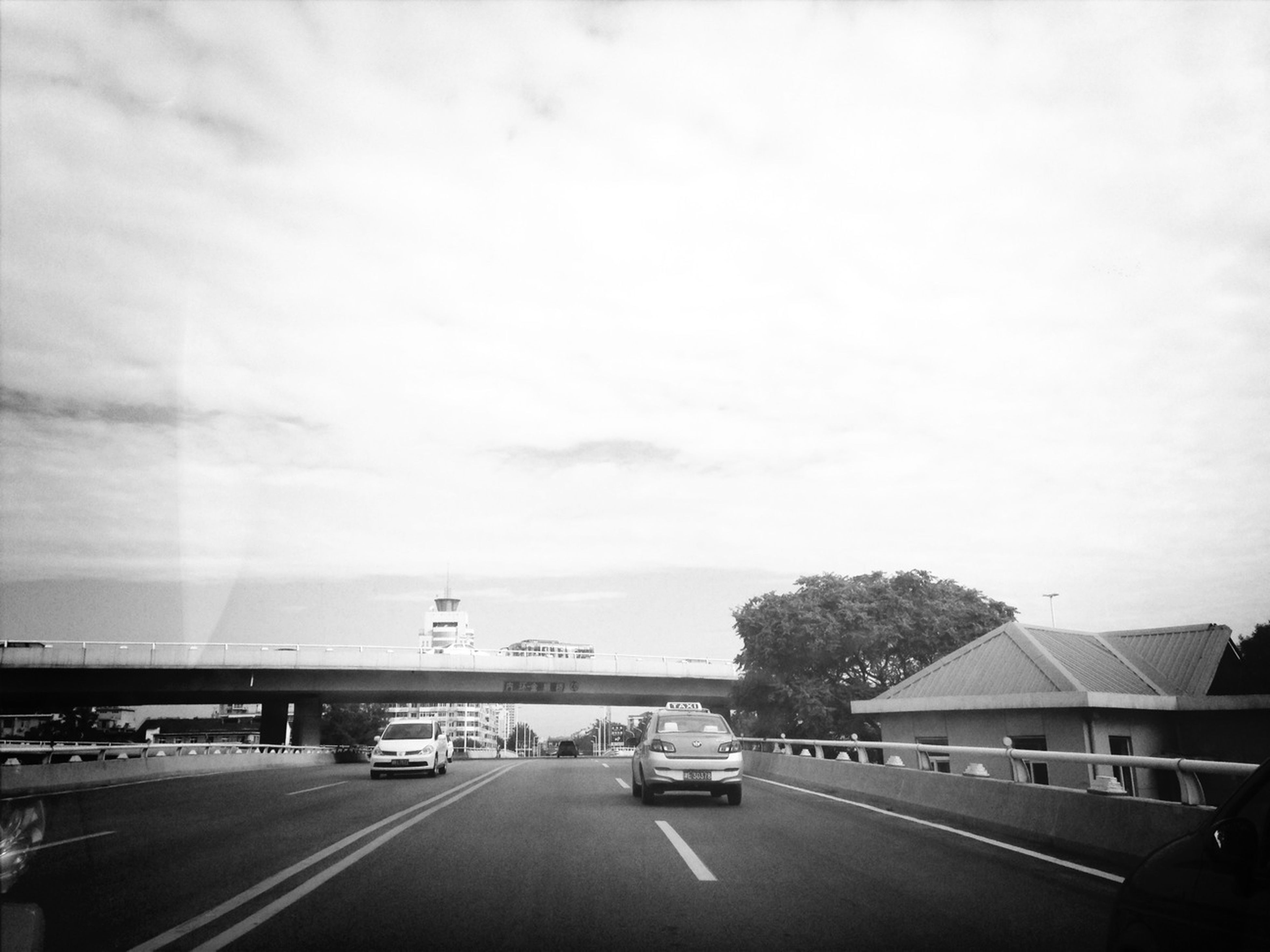 transportation, road, car, road marking, land vehicle, mode of transport, the way forward, sky, street, highway, cloud - sky, on the move, built structure, architecture, diminishing perspective, vanishing point, outdoors, travel, day, no people