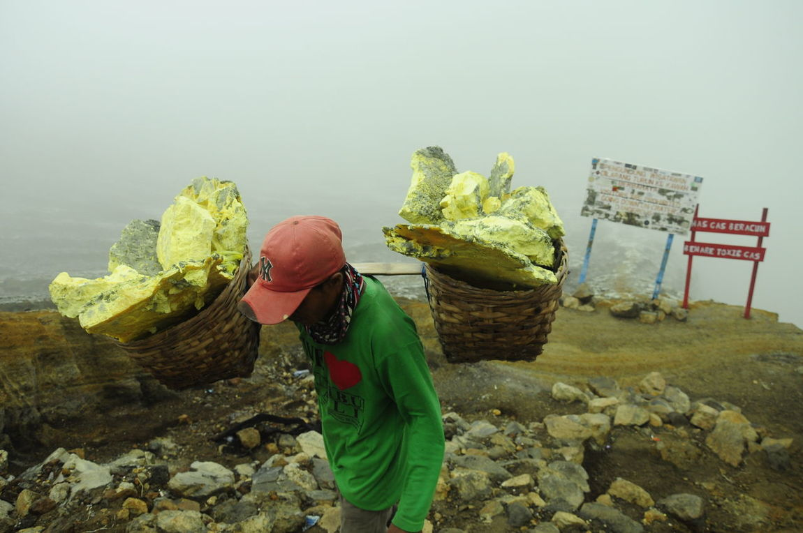 worker sulfur mining in ijen crater, bring 90kg in her shoulders and hold for a miles away to the top mountain. Carefree Culture Day Dirty Full Length Holding Ijen IjenMountain Labour Labour Day Messy Mining Non-urban Scene People And Places Sulfur  Sulfur Miners Sulfur Mountain Sulfur Rock Tourism Tranquil Scene Vacations Worker Snap A Stranger