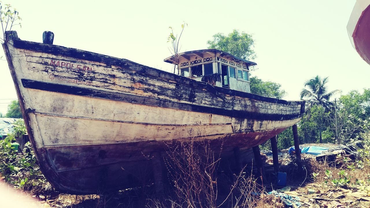 nautical vessel, abandoned, boat, damaged, no people, moored, run-down, wood - material, rusty, outdoors, day, transportation, clear sky, tree, sky, nature