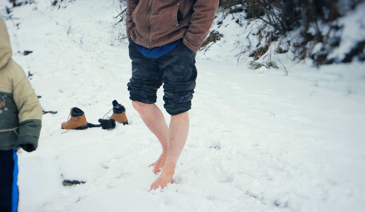 Low Section Of Man On Snow