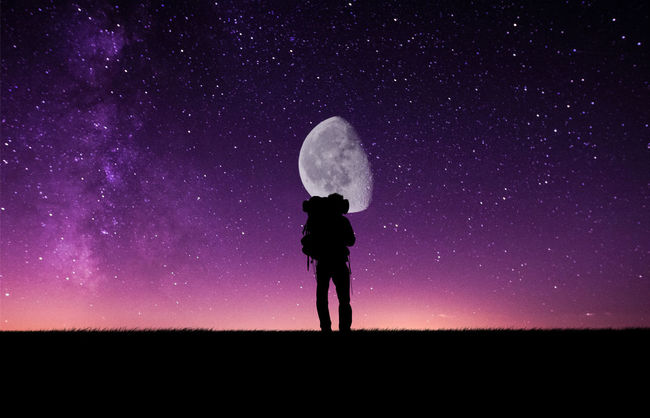 backpacker in front of the moon Astronomy Backpacking Beauty In Nature Blue Dark Discovery Exploration Field Full Length Idyllic Landscape Leisure Activity Lifestyles Moon Nature Night Outdoors Remote Scenics Sky Solitude Space Standing Tranquil Scene Tranquility Fresh On Market May 2016 Market Reviewers' Top Picks Fresh On Market 2016
