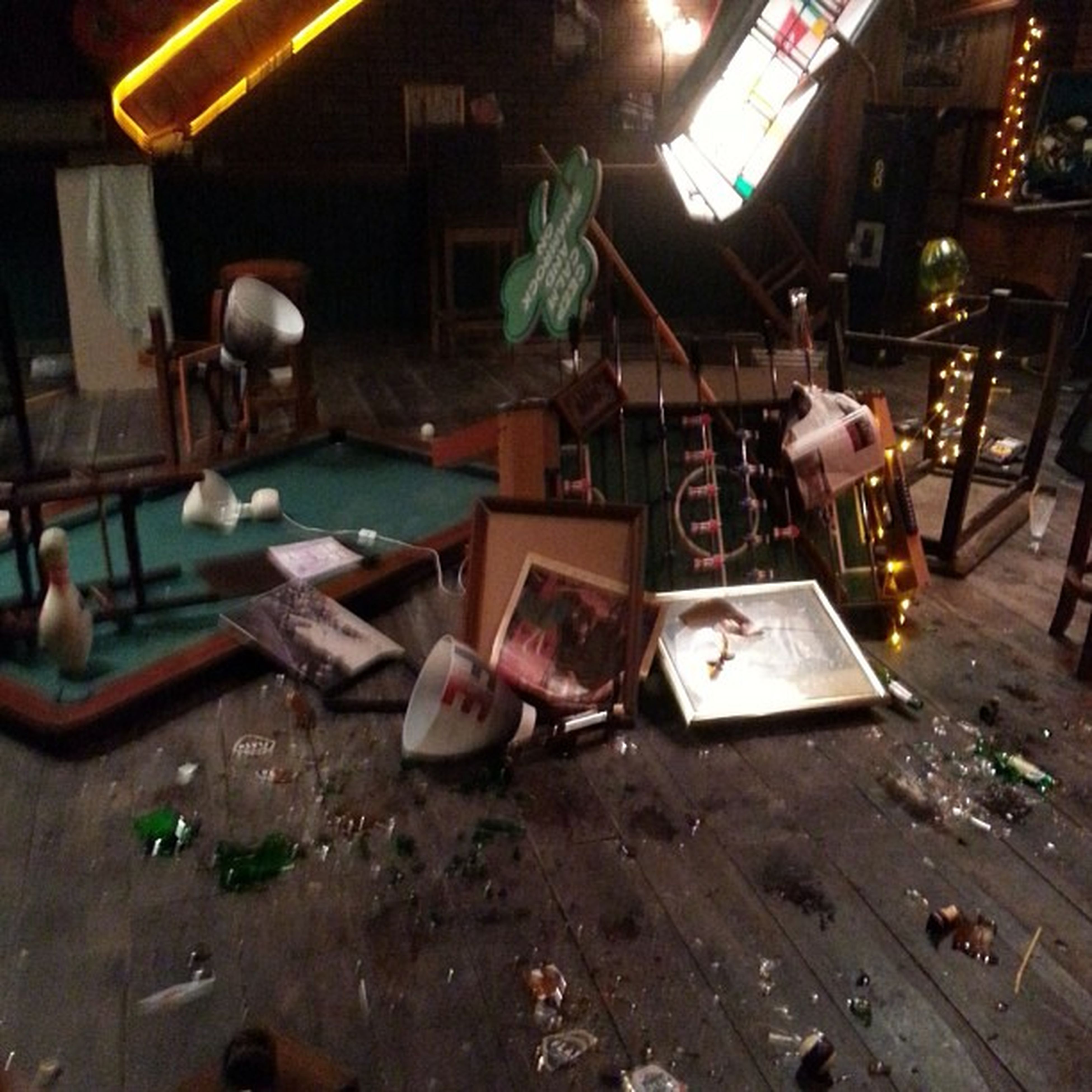 indoors, built structure, architecture, messy, abandoned, chair, night, table, building exterior, illuminated, house, high angle view, damaged, obsolete, no people, old, wood - material, absence