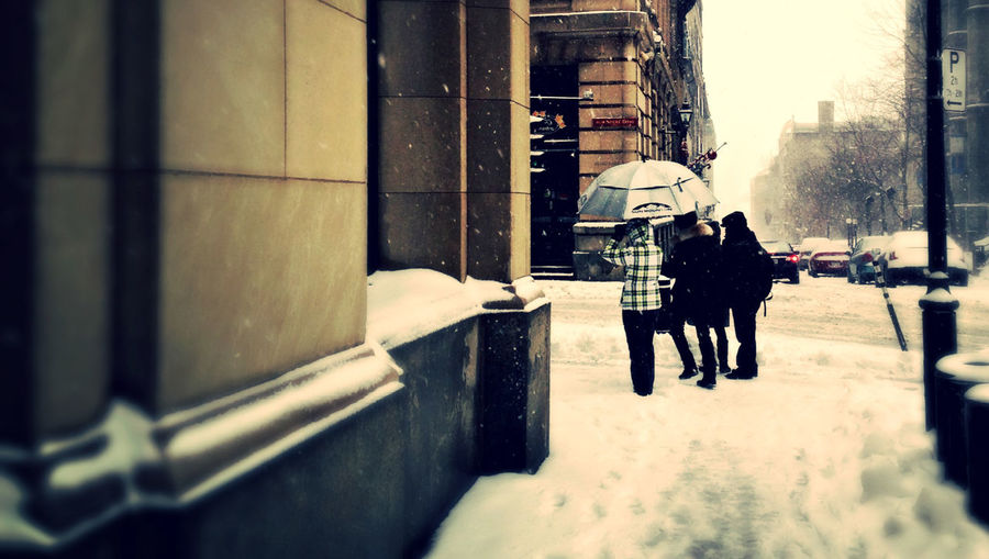 Walking in the snowstorm Notre-dame Street Old Montreal People Walking  Real People Rear View Selective Focus Sidewalk Snow Snow Storm Umbrella Walking Wall - Building Feature White Umbrella Winter