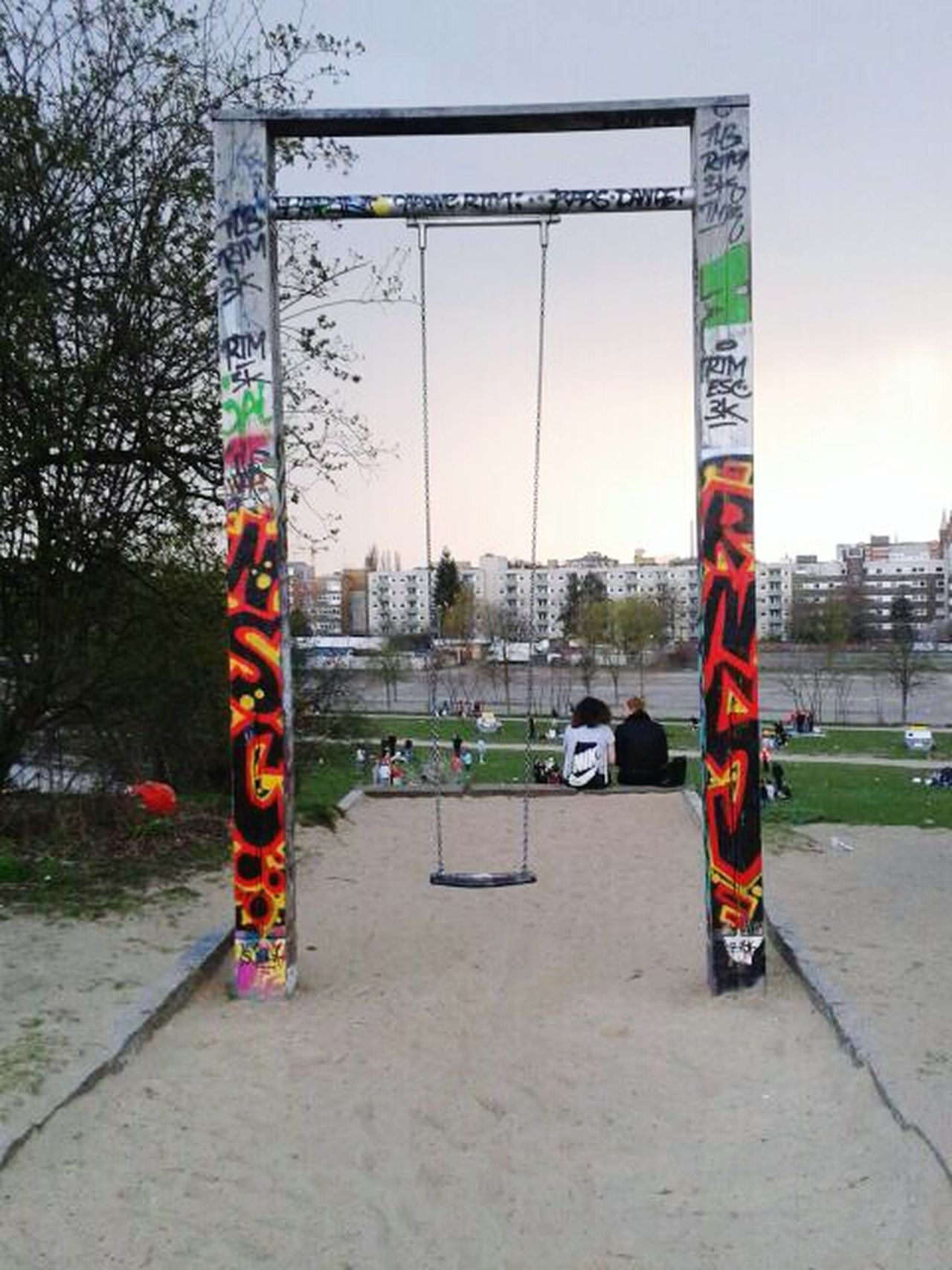 Tree Sky Outdoors Playground People Two People City Full Length Childhood Business Finance And Industry Adults Only Water Day Only Men Adult Geaffiti Berlin German Mauerpark Graffitiporn Graffiti The World Pictureoftheday