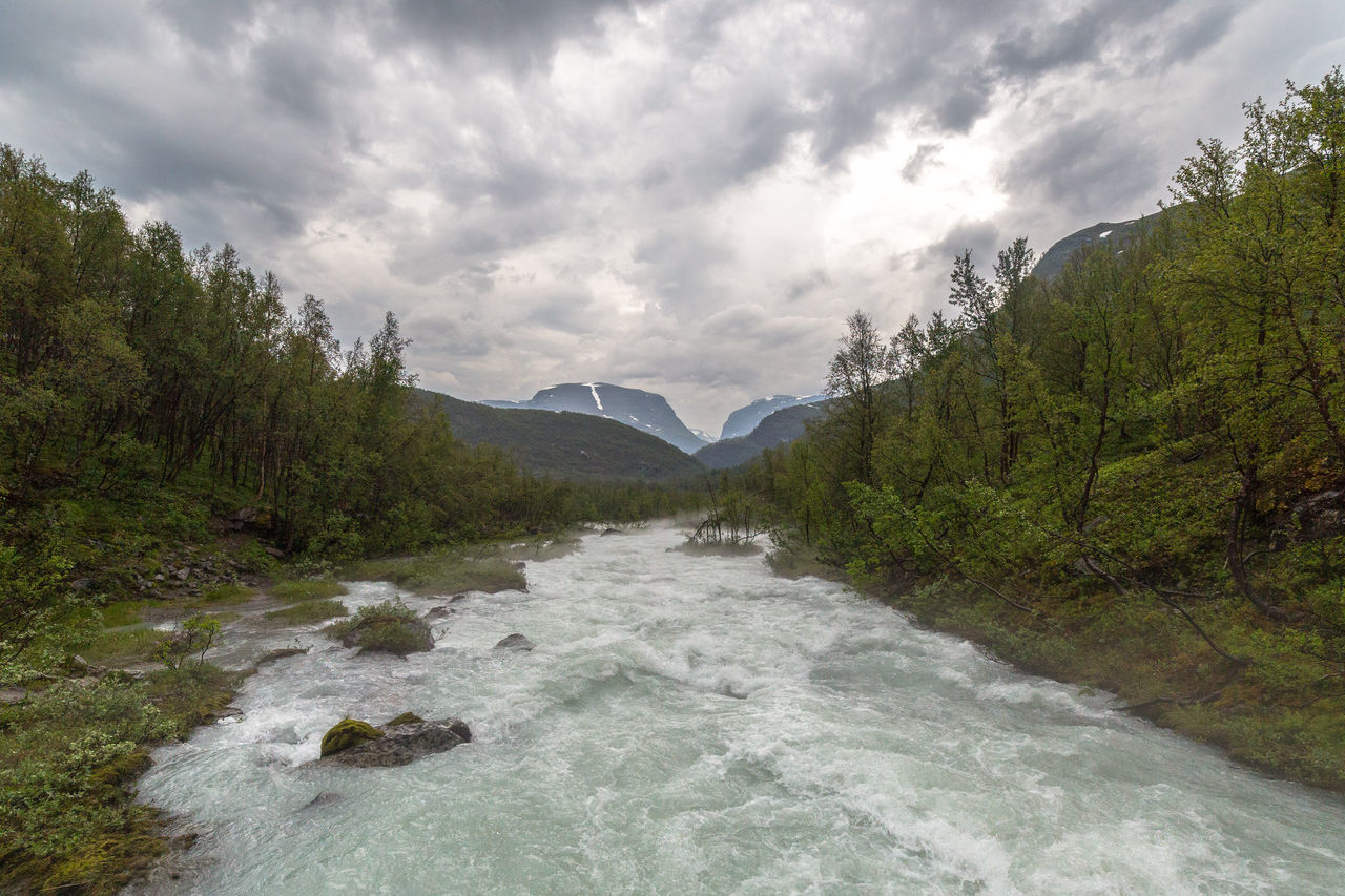 Beauty In Nature Cloud Cloud - Sky Cloudy Dramatic Sky Flowing Flowing Water Glacier River Green Color Idyllic Landscape Mountain Nature Northern Norway Norway River Scenics Sky Stream Thunderstorm Tree Water Waterfront