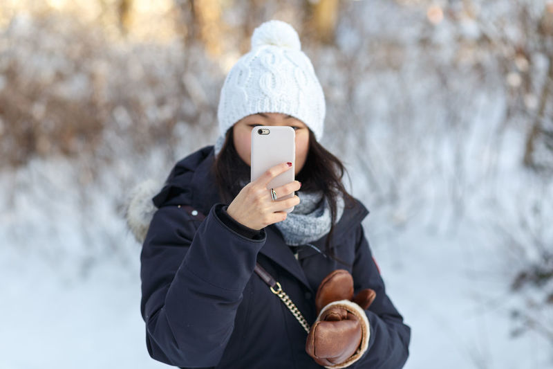 Winter Photographer. Asian  Chinese Cold Cute Front View Girl No Face Outdoors Photographer Real People Smartphone Smartphonephotography Taking A Photo Waist Up Winter Women Young Adult Young Women