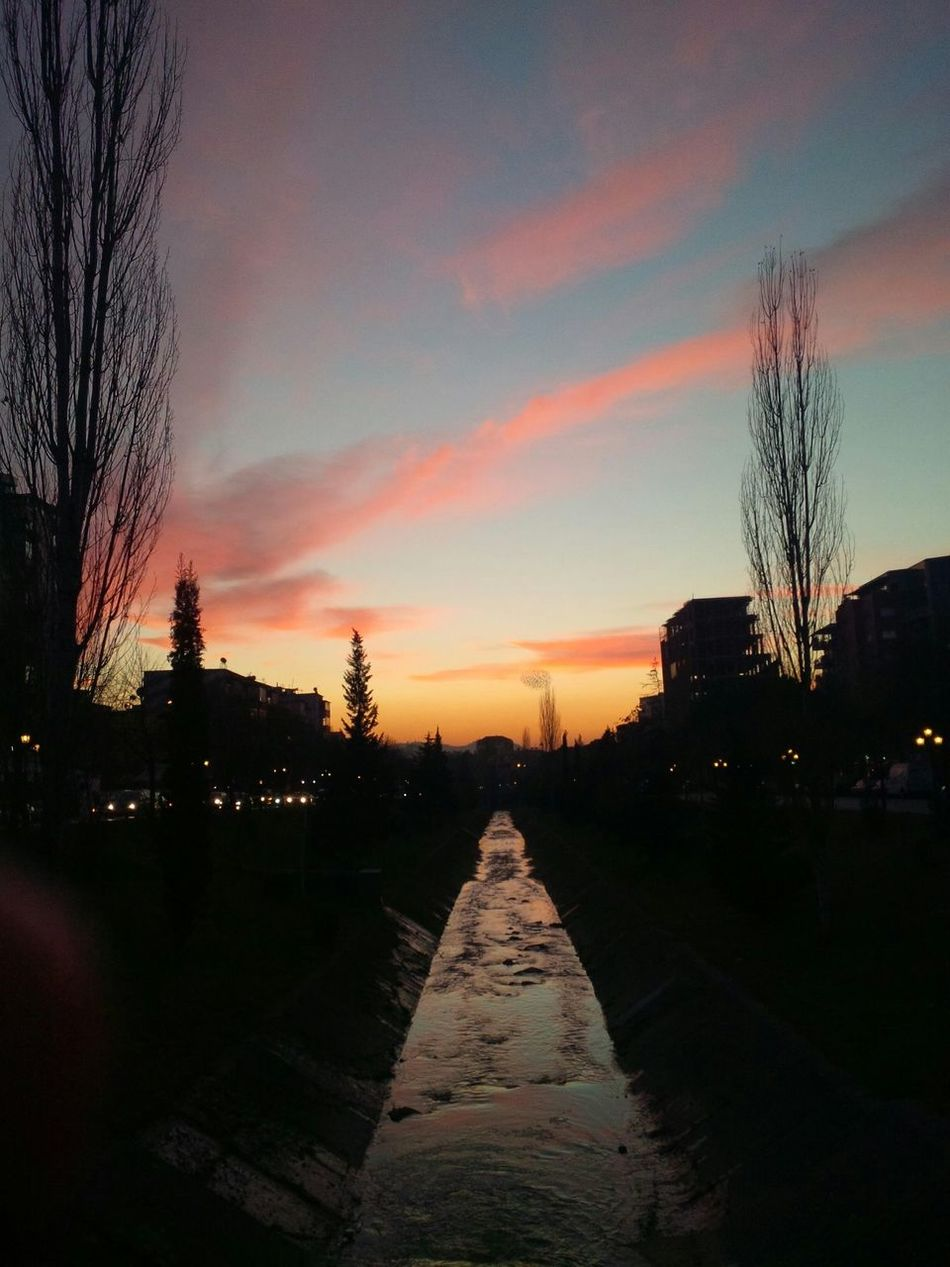 sunset Trees Sky And Clouds River Siluette Taking Photos Tirana EyeEm Blackberry10 Perspective Buildings